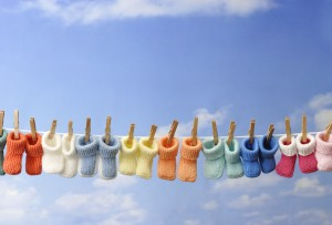 Every Day Sacred - several colorful baby booties on clothes line
